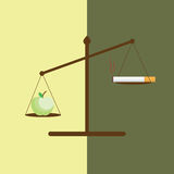 Conceptual image of an Apple and a cigarette on weight scale. Day of refusal of Smoking. No tobacco day. Stop smoking concept Stock Photos