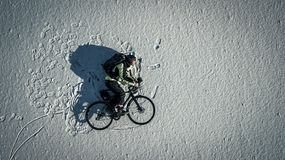 Conceptual image of bicyclist riding a bike. Stock Image