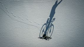Conceptual image of bicyclist standing near by bike. Stock Photo
