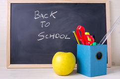Conceptual Image with a Blackboard and School Supplies stock photos