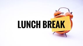 Conceptual image of Business Concept with words Lunch Break on a clock with a white background. Selective focus. Stock Image