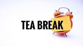 Conceptual image of Business Concept with words Tea Break on a clock with a white background. Selective focus. Royalty Free Stock Photo