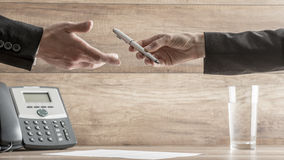 Conceptual image of Businessman Handing over a Pen to his Busine Royalty Free Stock Image