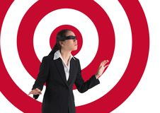 Conceptual image of businesswoman with black band on eyes against archery board stock photos