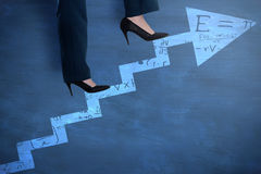 Composite image of conceptual image of businesswoman in heels climbing steps Royalty Free Stock Photo