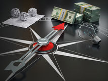 Conceptual image of compass directing at money. Course concept Stock Photos