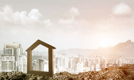 Conceptual image of concrete home sign on hill and natural lands Stock Photos