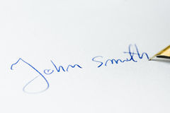 Conceptual image containing a signature made with a pen Royalty Free Stock Photos