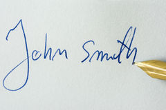 Conceptual image containing a signature made with a pen. John Smith Royalty Free Stock Image