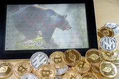 Conceptual image for cryptocurrency bubble. Bear market on tablet graph Stock Images