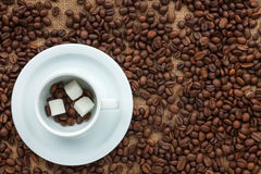 Conceptual image of a cup of coffee and sugar Stock Photo