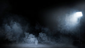 Conceptual image of a dark interior full of swirling smoke Royalty Free Stock Photo