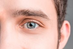 The conceptual image of digital eye of a young man and eoman Stock Photos