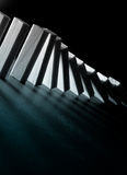 Conceptual Image of The Domino Effect Stock Photos
