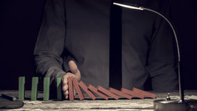 Conceptual image of the Domino Effect Stock Image