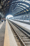 Conceptual image of european railway station and Commuters on platform Royalty Free Stock Image