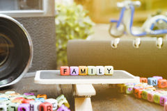 conceptual image with FAMILY word block on wooden signage Royalty Free Stock Photos