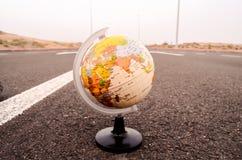 Globe Earth on an Asphalt Street. Conceptual Image Globe Earth on an Asphalt Street royalty free stock photos