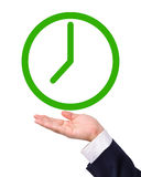 Conceptual image, green clock on hand. Stock Image