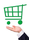 Conceptual image, green shopping cart on hand. Stock Photos