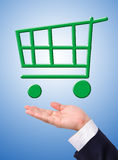 Conceptual image, green shopping cart on hand. Royalty Free Stock Photography