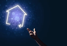 Conceptual image with hand pointing at house or main page icon o Royalty Free Stock Photo