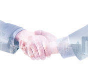 Conceptual image of a handshake on a white background Royalty Free Stock Photo