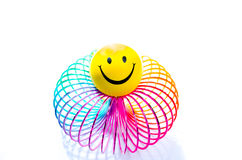 Smiley on a rainbow Slinky toy Royalty Free Stock Photography