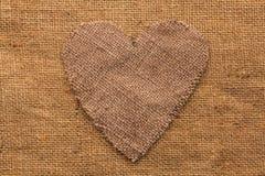 Conceptual image of the heart  lying on sackcloth Stock Photos