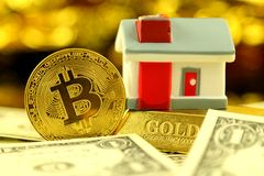 Conceptual image for investors in cryptocurrency new virtual money, gold, real estate and dollars Stock Photos