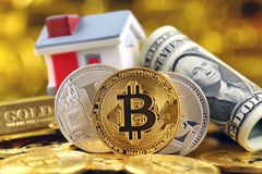 Conceptual image for investors in cryptocurrency new virtual money, gold, real estate and dollars Royalty Free Stock Image