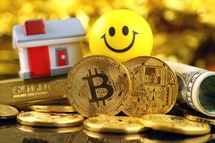Conceptual image for investors in cryptocurrency new virtual money, gold, real estate and dollars.  royalty free stock image