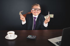 Conceptual image King of Banks. Successful banker holding money Royalty Free Stock Photo