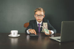 Conceptual image King of Banks. Successful banker holding money Stock Photography