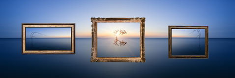 Conceptual image of landscape pictures hanging in frames above c Royalty Free Stock Photography