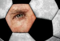 Conceptual image of man blue eye composite with leather classic texture soccer ball in sport supporter fan and watching football g royalty free stock photography