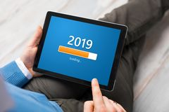 Conceptual image of man looking at tablet and getting ready for New Year royalty free stock photos