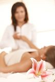 Conceptual image of massage salon. Focus placed on the flower in front Stock Photos