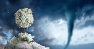Conceptual image of money tree in money pile over storm sky and. Approaching tornado stock image