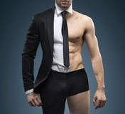 Conceptual image of muscular fit businessman Royalty Free Stock Photos