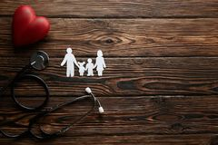 Conceptual image of paper chain in form of family. health insuarance accessories stock photography