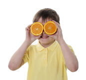 Conceptual image of a person holding oranges Royalty Free Stock Photography