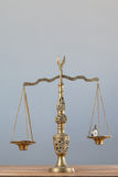 Conceptual image of pocket watch on justice scale Stock Photo
