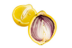 Red onion inside yellow lemon. Conceptual image of a red onion inside the peel of a lemon Stock Photography