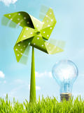 Conceptual image of renewable eco friendly wind power energy. Conceptual image of alternative eco friendly wind power energy with a green toy windmill in fresh Stock Image