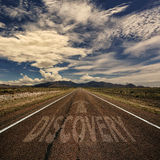 Conceptual Image of Road With the Word Discovery. Conceptual image of desert road with the word discovery and arrow Stock Photo