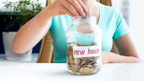 Conceptual image of saving money for buying new house. Conceptual photo of saving money for buying new house royalty free stock images