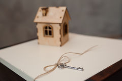 Conceptual image with small wooden house and keys Stock Images