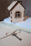 Conceptual image with small wooden house and keys Royalty Free Stock Photo