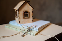Conceptual image with small wooden house and keys Stock Image